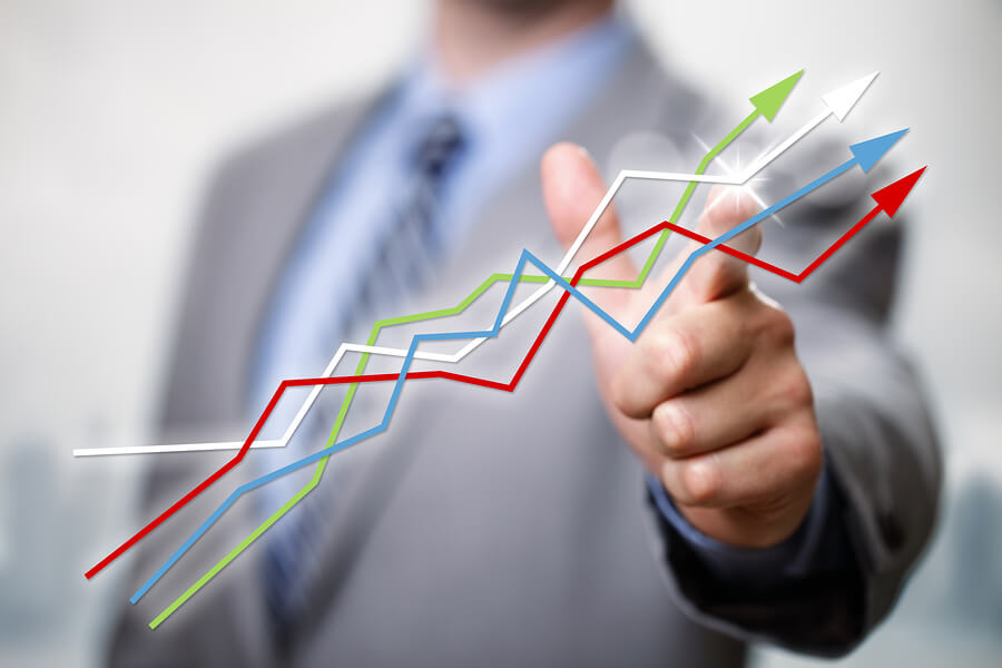 bigstock-Businessman-pointing-to-growth